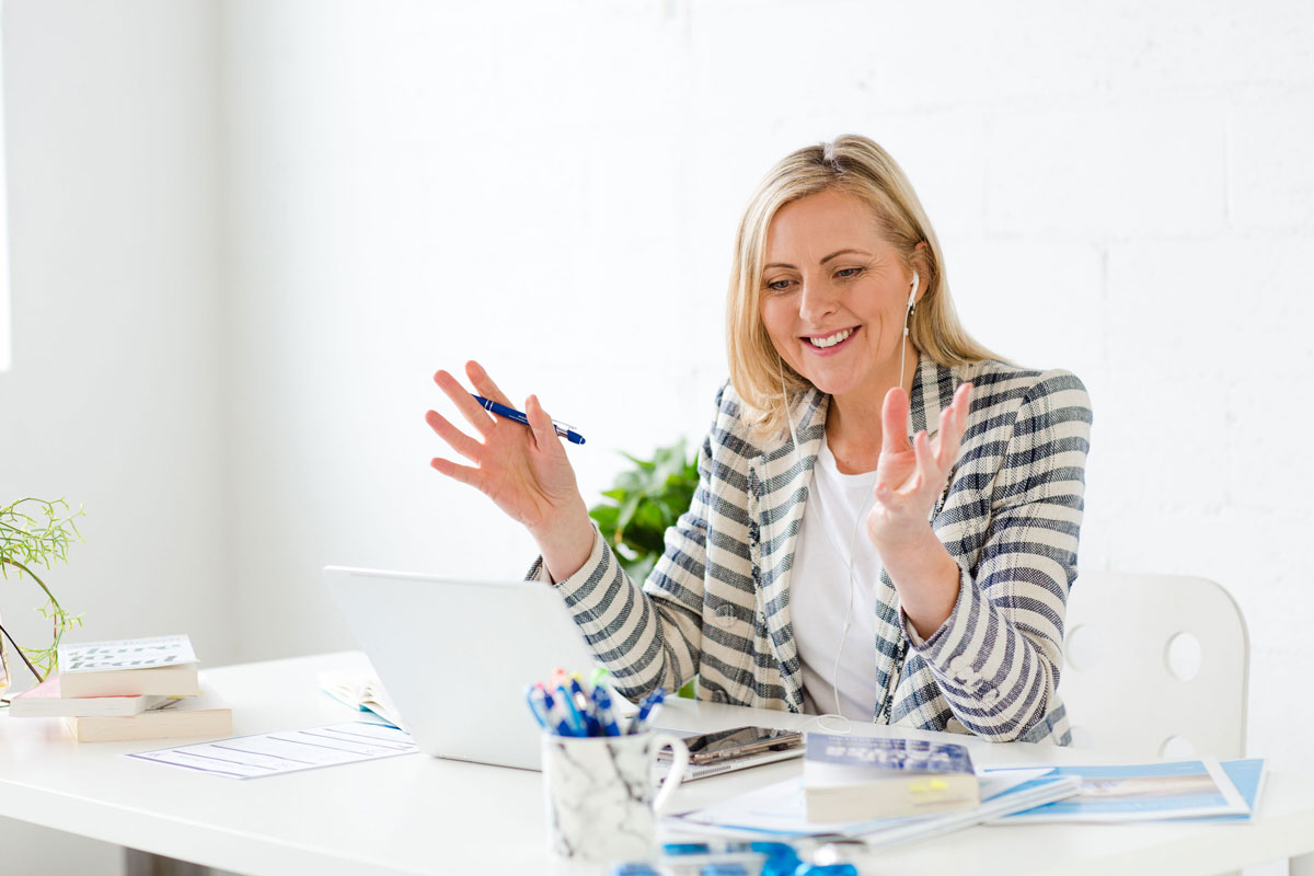 Wendy Cole Productivity coach working at desk effectively